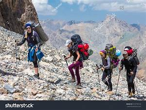 Group Mountaineer Walking On Deserted Rocky Stock Photo ...