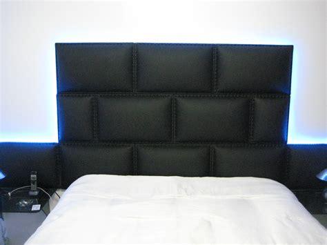 masculine black upholstered wall panel headboard  men
