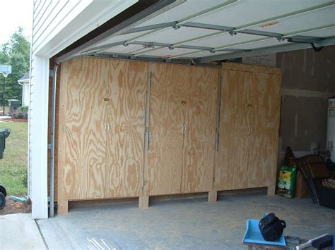 enclosed garage shelves  lockable plywood doors