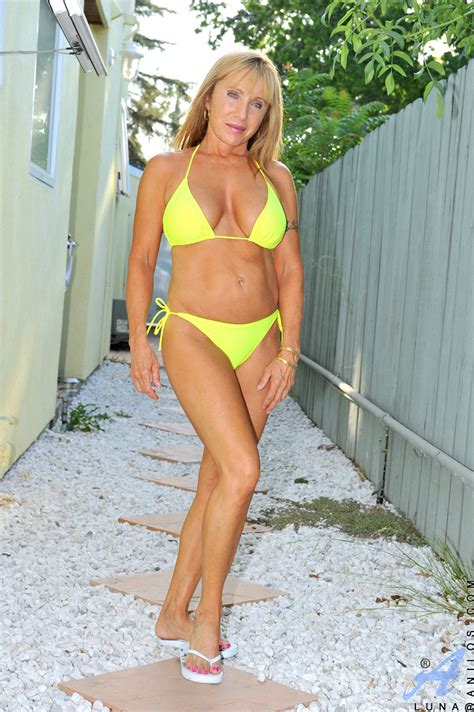 Busty milf Luna wears a bikini and gives a peek of her sizzling hot mature frame as she chills ...