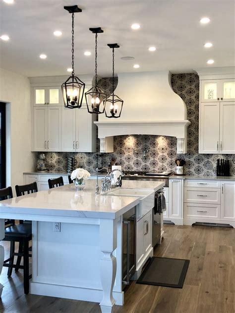 white kitchen  patterned cement tile backsplash