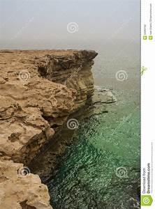 Rocky Steep Cliff Of Cyprus Coast To Deep Blue Green ...