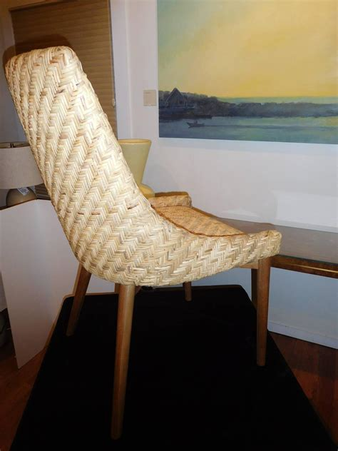 pair of modern seagrass and cherrywood chairs for sale at
