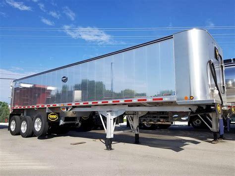 mac trailer ft  tri axle aluminum frameless  dump trailer air ride fixed axle