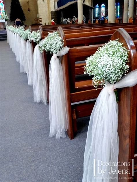 babies breath and blush tulle wedding ceremony pew end