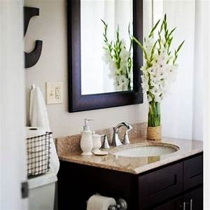 diyplaybook uses fresh flowers and white bathroom With spa like bathroom accessories