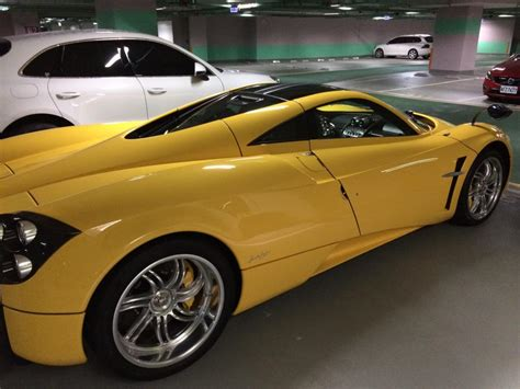 old pagani yellow pagani huayra spotted at ipe factory owned by a