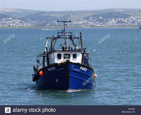 heading trawler fishing port into alamy