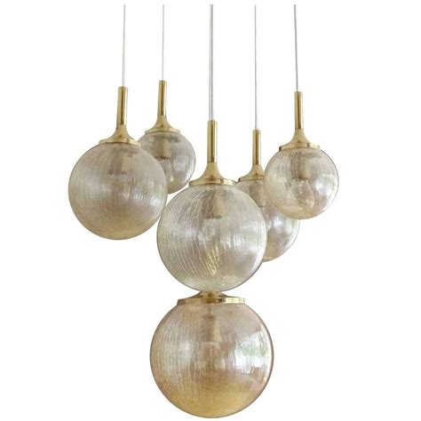 large limburg glass globes and brass chandelier 1960s