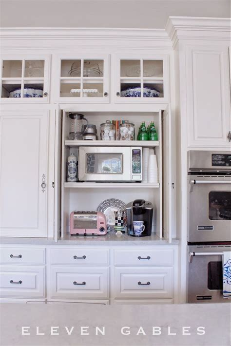 Hidden Appliance Cabinet and Desk Command Center in the