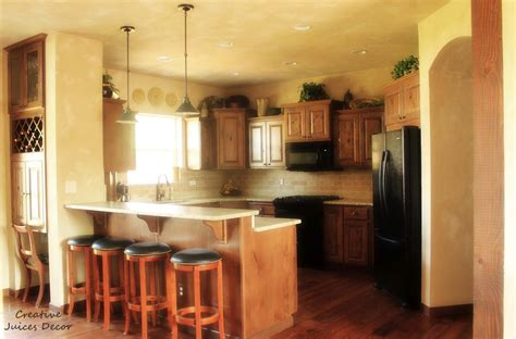 decorating ideas for top of kitchen cabinets creative juices decor decorating the top of your kitchen