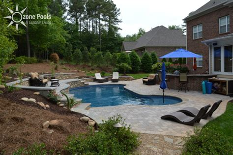 river rock pool  outdoor kitchen grilling area
