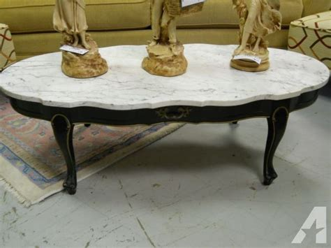 marble top coffee table w black wood base 60 40