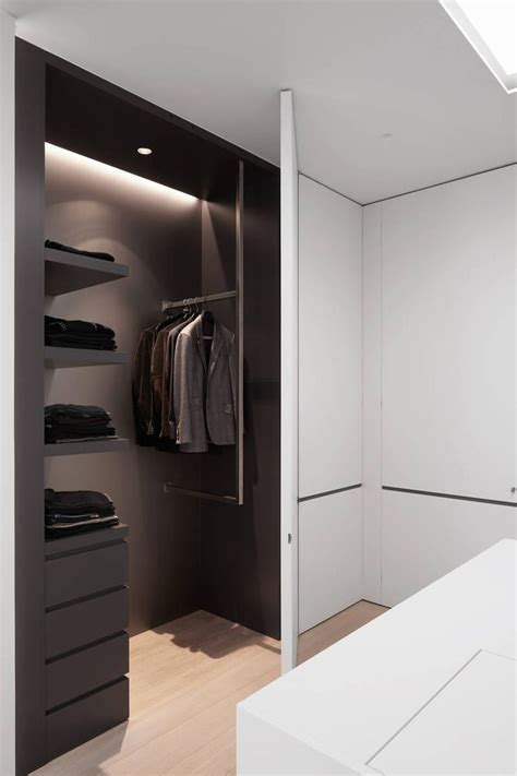 his and hers walk in closet concept with ceiling design