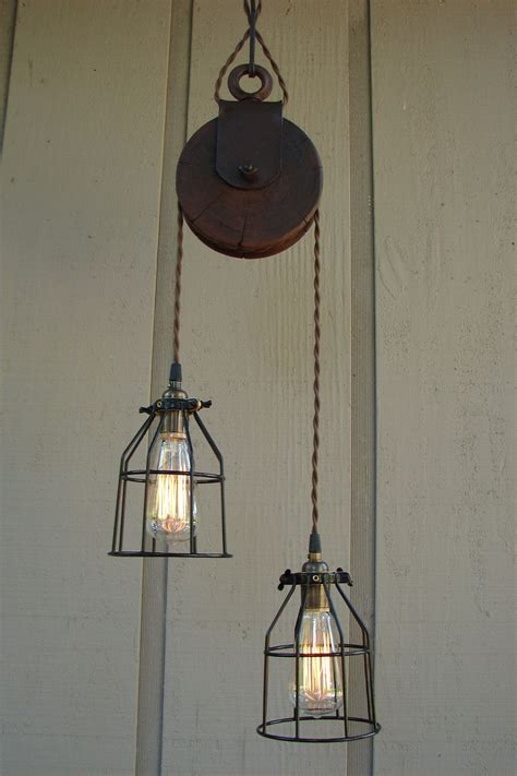 Farm Lighting by Reserved For Diane Upcycled Farm Pulley Lighting Pendant