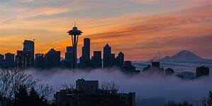 Sunrise Seattle Skyline Above The Fog Photograph by Mike Reid