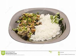 Fried Mussels With Rice On The Black Plate Royalty Free ...