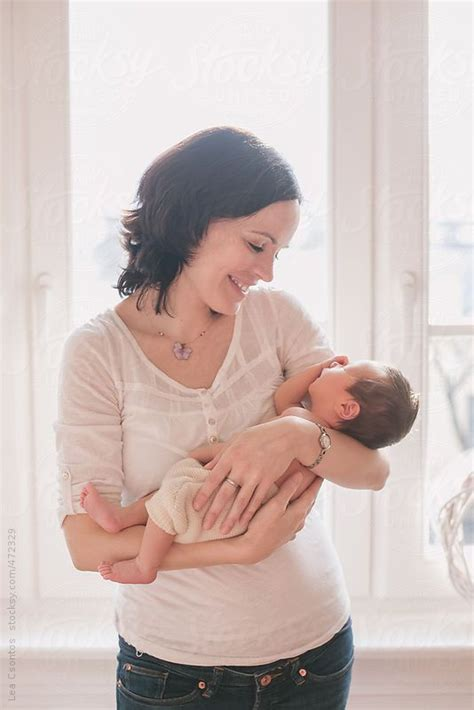 happy mother holding  newborn baby   arms