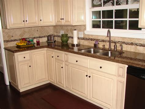 brown cabinets with white countertops antique white raised panel cabinets and tropical brown
