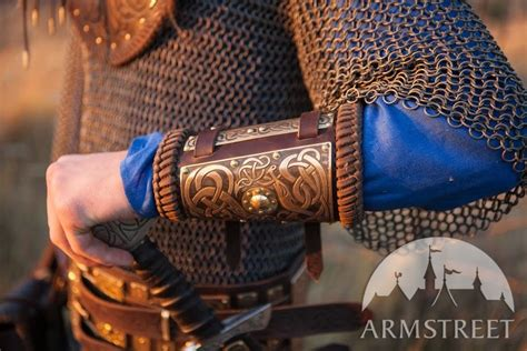 viking bracers  etched brass accents
