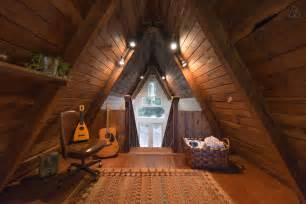 small a frame cabin this tiny house looks like only roof but inside whoa