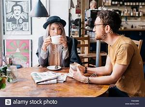 Sweden, Vastra Gotaland, Two people drinking coffee in ...