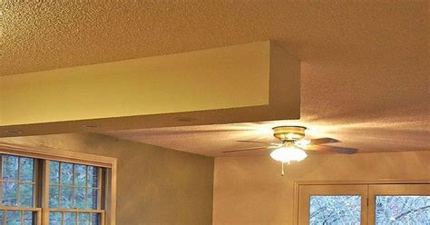 homeowner rips out dated popcorn ceiling in favor of a
