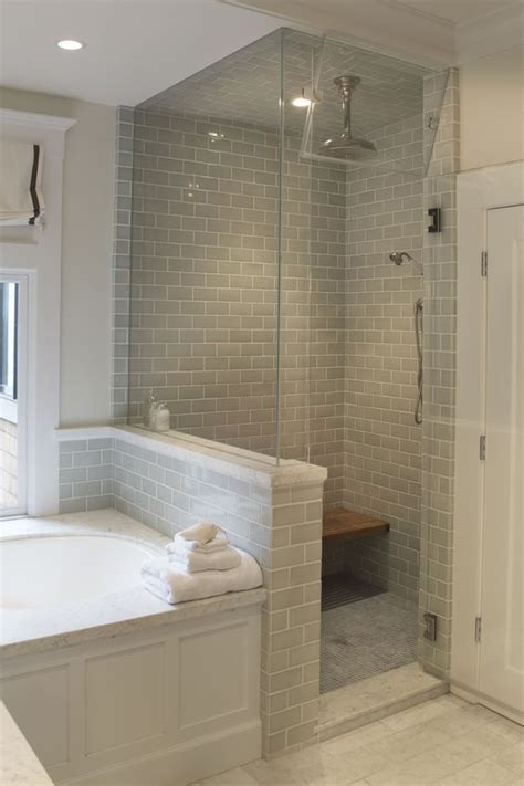 glass enclosed steam shower with pony wall to separate the