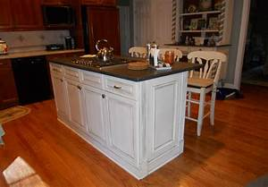 kitchen cabinet island with white color and black top With kitchen cabinet with island design