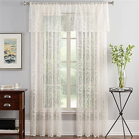 abstract lace sheer window curtain panel in ivory bed