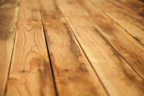 hardwood floors hurt hardwood floor vs laminate which flooring gives the biggest bang for your buck