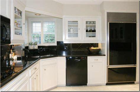 small stylish kitchen black appliances  corner lamp