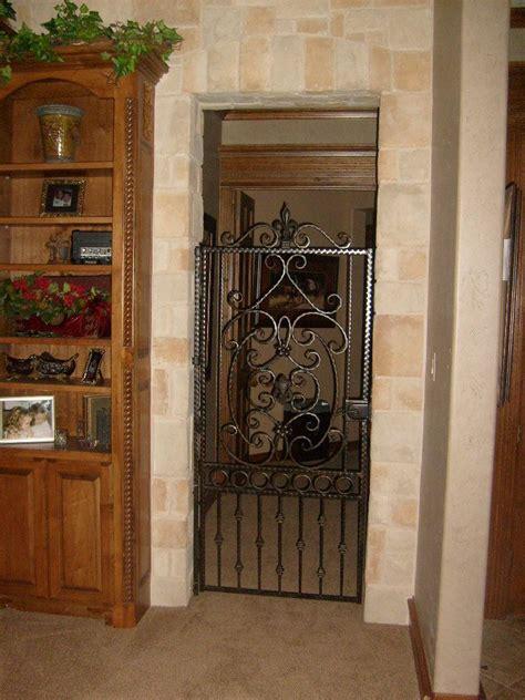 custom iron door  scrolls  fleur de lis  world