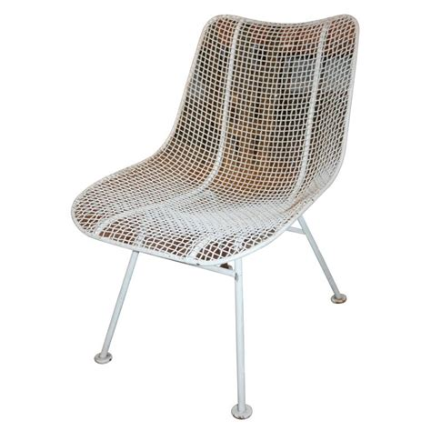 two dozen jet age wire mesh outdoor chairs by woodard at