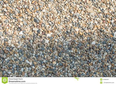 crushed granite and pebble gravel texture stock image