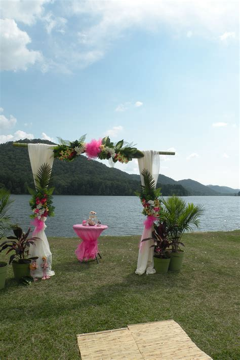 diy tropical theme wedding arch and sand ceremony do it