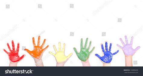 childrens hands painted rainbow colors border stock photo