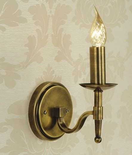 single or double arm antique brass wall light