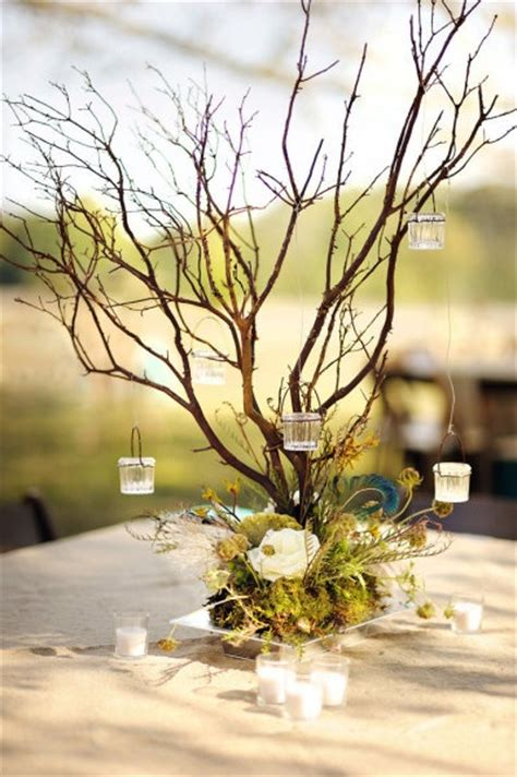 branches and hanging votives rustic wedding centerpiece