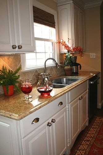 white cabinets with beige countertop kitchen remodel after granite counters and white cabinets