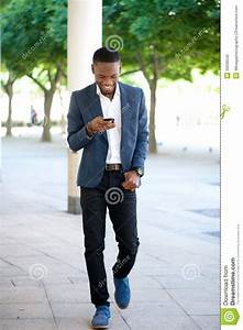Happy Young African Man Reading Text Message Royalty-Free ...