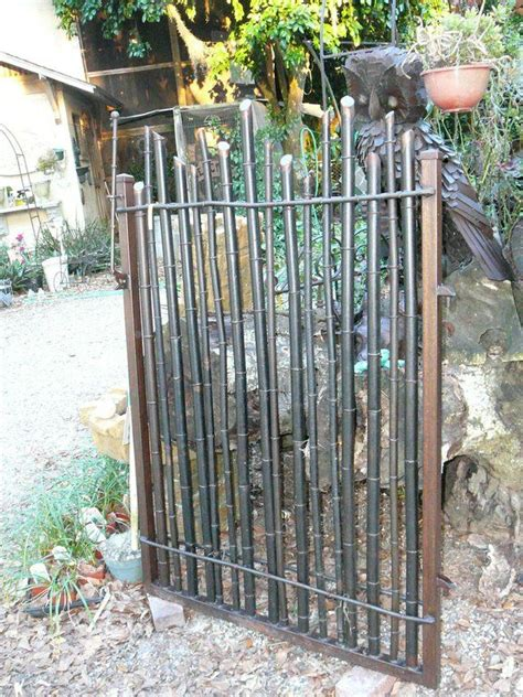 bamboo gate idea nicely done with the gunmetal steel colored paint re scape exteriors