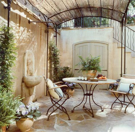 Tuscan Style Area Rugs by Transformation Of A French Cottage Mediterranean Patio