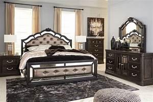 Quinshire brown upholstered panel bedroom set from ashley for Bedroom furniture sets b q