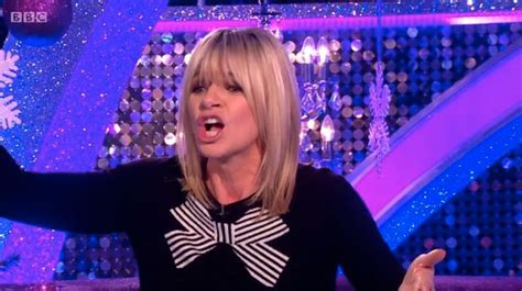 Zoe Ball looks fresh-faced after snog with boyband star as ...