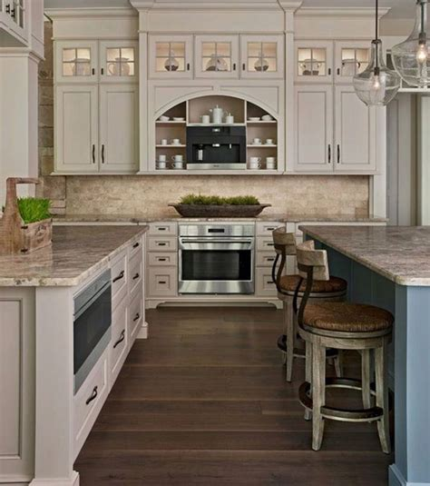 white kitchen with bronze tin backsplash and brown tile