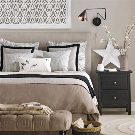 neutral bedroom  black accents traditional bedroom