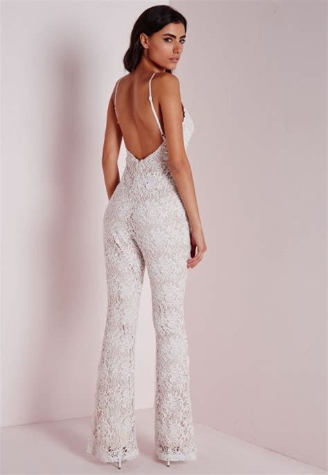 lace jumpsuit white missguided flared leg lace jumpsuit ivory in white lyst