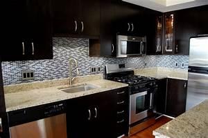 Dark cabinets with tile backsplash the interior design for Kitchen backsplash pictures with dark cabinets