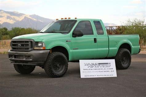 buy   ford  diesel  lariat crew cab wd